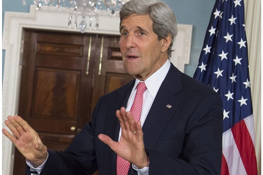 US Secretary of State John Kerry speaks prior to meetings with Estonian Foreign Minister Urmas Paet (not seen)at the US State Department in Washington, DC on May 29, 2014. -- PHOTO: AFP
