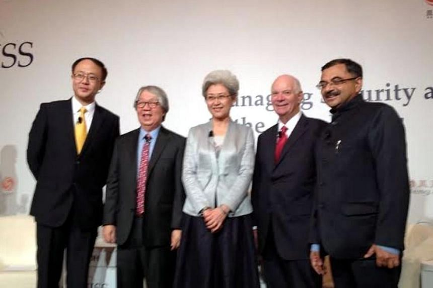 Singapore's Ambassador-at-large Tommy Koh (second from left), Fu Ying, chair of the Foreign Affairs Committee of China's National People's Congress, US Senator Ben Cardin and Indian MP Tarun Vijay, at a live debate hosted by China's Phoenix TV,