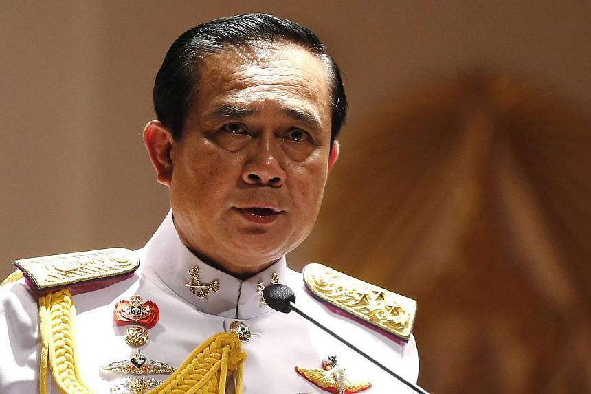Thai army chief and junta head General Prayuth Chan-ocha speaks to journalists during a news conference at the Royal Thai Army headquarters in Bangkok, Thailand, on May 26, 2014.