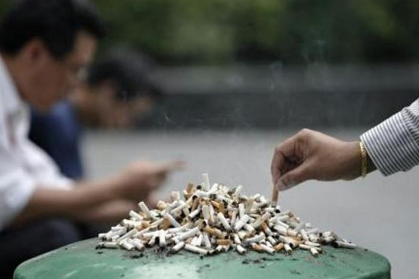 Stubbed-out cigarettes left on a dustbin. The Health Promotion Board (HPB) announced two initiatives on Saturday, which is World No Tobacco Day, to tackle smoking here. -- PHOTO: ST FILE
