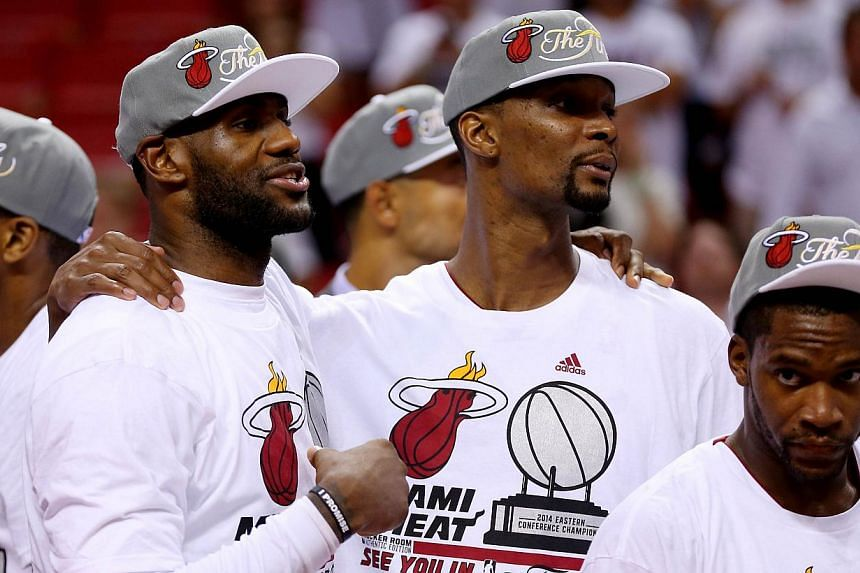LeBron James, Chris Bosh and Toney Douglas of the Miami Heat celebrate after defeating the Indiana Pacers in Game Six of the Eastern Conference Finals of the 2014 NBA Playoffs at American Airlines Arena on May 30, 2014 in Miami, Florida.James a