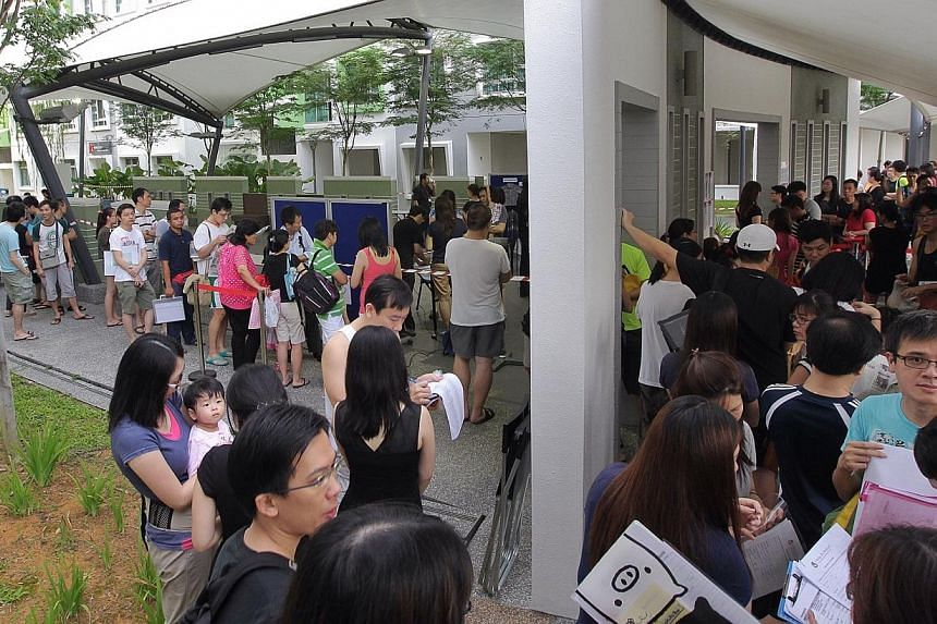 The snaking queue at EtonHouse's E-Bridge childcare centre in Punggol yesterday. People had started lining up the day before.