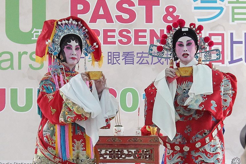 Cantonese opera singers performing on stage on June 1, 2014, at the opening of the 30 Years - Ang Mo Kio Past To Present festival village, as part of the PAssionArts Festival 2014 by the People's Association. -- ST PHOTO: NEO XIAOBIN