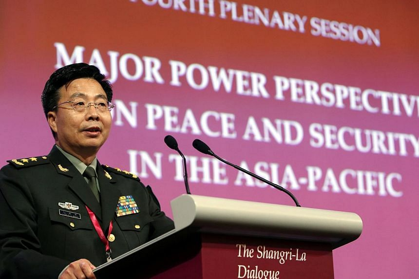 Lieutenant-General Wang Guanzhong, deputy chief of the general staff of the People's Liberation Army, speaks during a plenary session at the 13th International Institute for Strategic Studies (IISS) Asia Security Summit: The Shangri-La Dialogue, in S