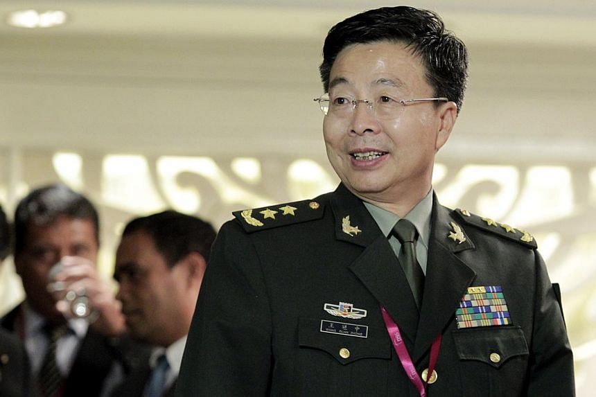 Lieutenant-General Wang Guanzhong, deputy chief of the general staff of the People's Liberation Army, at the 13th Shangri-La Dialogue in Singapore on May 31, 2014. -- ST PHOTO: NEO XIAOBIN