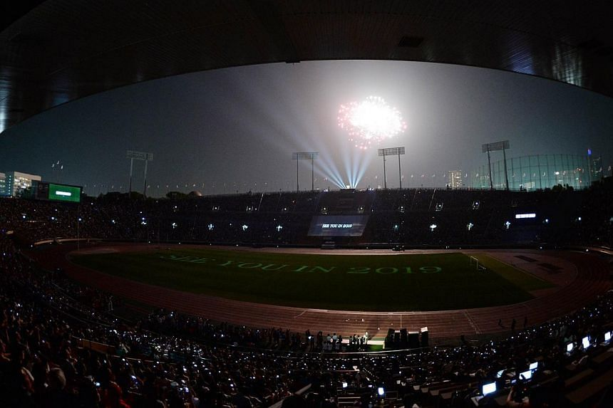 A fireworks display is seen over Japan's national stadium during the stadium's official farewell event in Tokyo on May 31, 2014. -- PHOTO: AFP