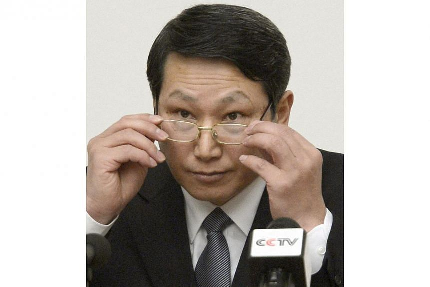 South Korean missionary, identified by the North as Kim Jong Uk, adjusts his glasses during a news conference in Pyongyang in this Feb 27, 2014 file photo provided by Kyodo. North Korea sentenced Kim Jong Uk to life with hard labour on May 30, 2014 a