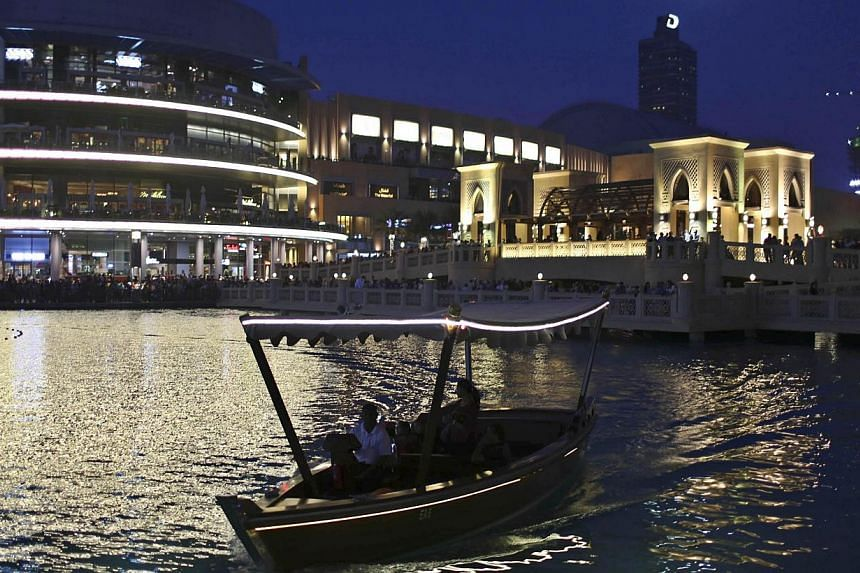 Dubai's Emaar Properties said on Sunday that its Emaar Malls Group has raised a US$1.5 billion (S$1.9 billion) syariah-compliant loan through a consortium of local banks to optimise its capital structure ahead of a planned listing of the unit. -- PHO