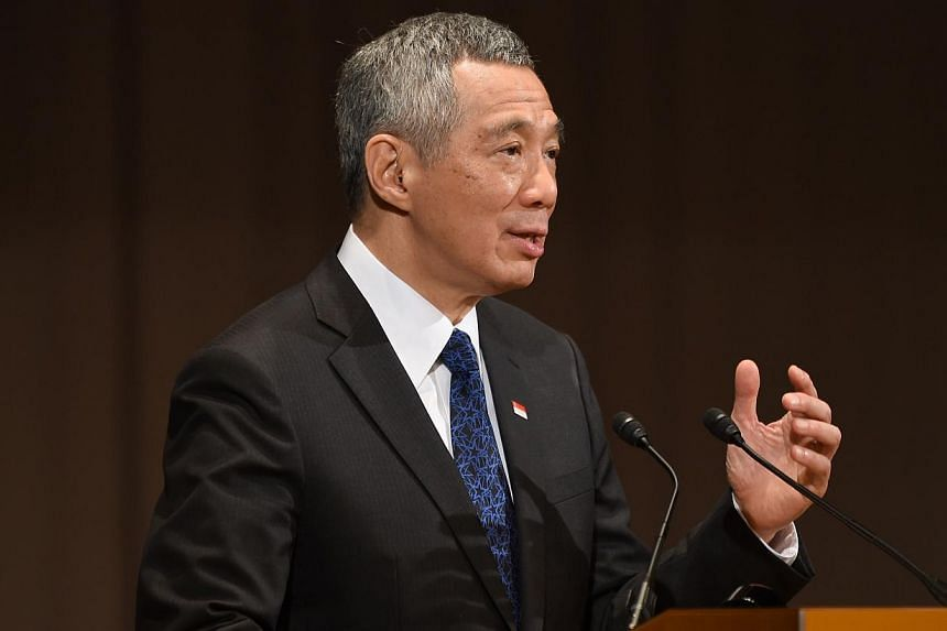 "Singapore Prime Minister Lee Hsien Loong delivers a speech during the 20th International Conference on the Future of Asia in Tokyo on May 22, 2014. Improving Singapore is a ""journey without end"", and the island-state can learn from other cities"