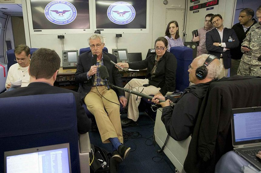 US Defence Secretary Chuck Hagel speaks during his flight abroad a U.S. military aircraft on June 1, 2014. United States Defence Secretary Chuck Hagel arrived in Afghanistan on a surprise visit on Sunday, following the release of soldier Bowe Be