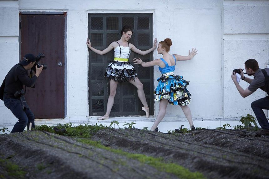 Models take part in the Trashion Fashion Show on the roof of a building in the Brooklyn Navy Yard in the Brooklyn borough of New York on May 31, 2014. -- PHOTO: REUTERS
