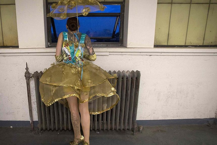 A model takes part in the Trashion Fashion Show on the roof of a building in the Brooklyn Navy Yard in the Brooklyn borough of New York on May 31, 2014. -- PHOTO: REUTERS