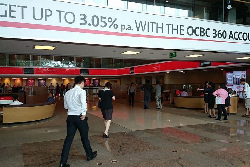 Young professionals have been flocking to OCBC's recently launched 360 account, with the bank reporting more than 18,000 people signing up for the account within the first month of its launch. -- PHOTO: OCBC