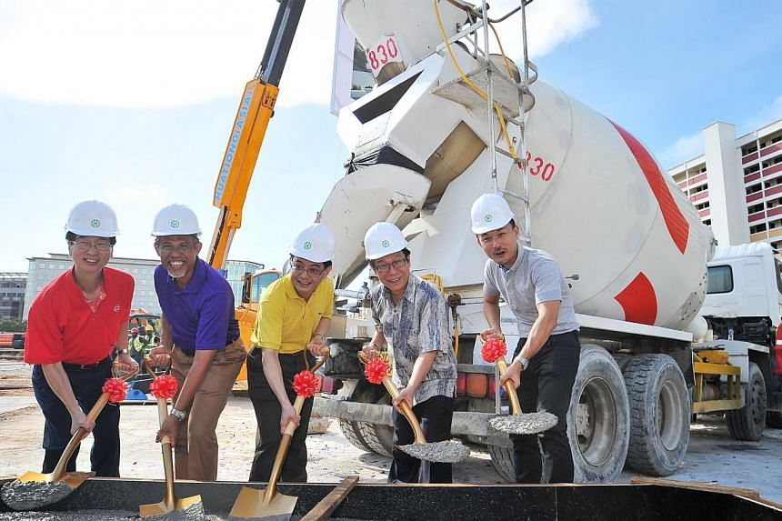(From left) People's Association chief Ang Hak Seng, Senior Minister of State for Home Affairs and Foreign Affairs Masagos Zulkifli, Education Minister Heng Swee Keat, and Tampines MPs Mah Bow Tan and Baey Yam Keng starting off the construction work