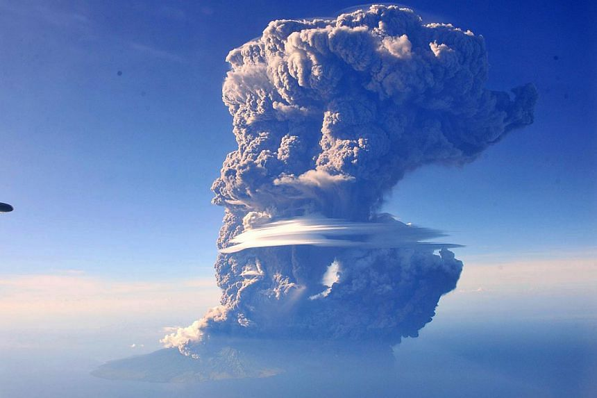 Mount Sangeang Api spews pyroclastic smoke as seen from commercial flight taken by Sofyan Efendi a profesional photographer during a flight from Bali to Labuan Bajo in Bima district, West Nusa Tenggara province, Friday afternoon on May 30, 2014. -- P