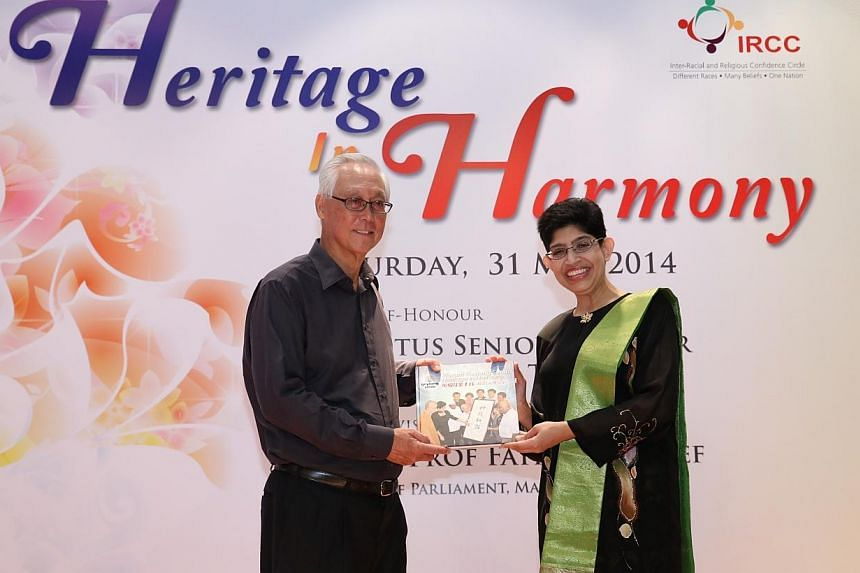 Emeritus Senior Minister Goh Chok Tong and Associate Professor Fatimah Lateefwith the Vibrant Geylang Serai: Heritage In Harmony coffee table book.-- PHOTO: MINISTRY OF CULTURE, COMMUNITY AND YOUTH