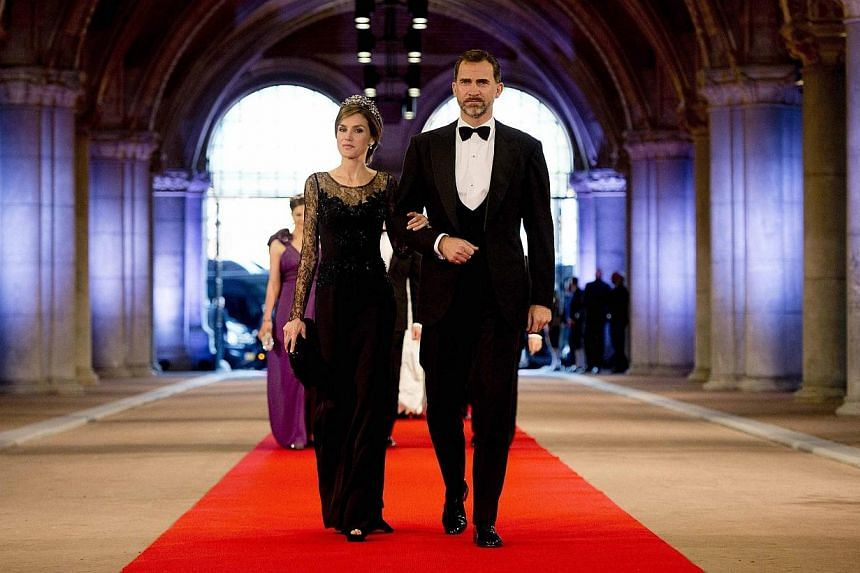 Spanish Crown Prince Felipe (right) and his wife Princess Letizia arrive at a gala dinner organised on the eve of the abdication of Queen Beatrix of the Netherlands and the inauguration of her successor King Willem-Alexander at the Rijksmuseum in Ams