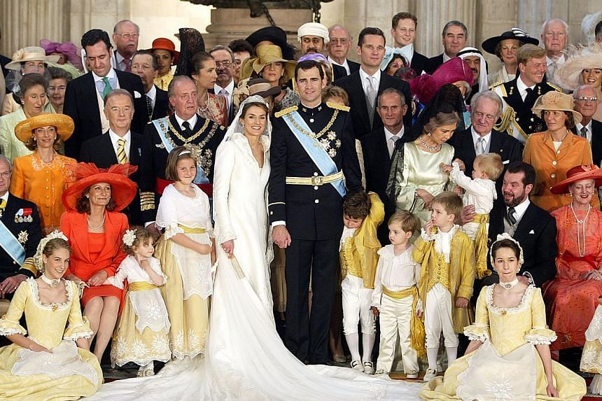 Spanish Crown Prince Felipe of Spain (centre-right) his wife Princess of Asturias Letizia Ortiz and King Juan Carlos of Spain (third row, 4th left) and Queen Sofia (third row, 4th right), posing for a family photo at the Royal Palace in Madrid on May