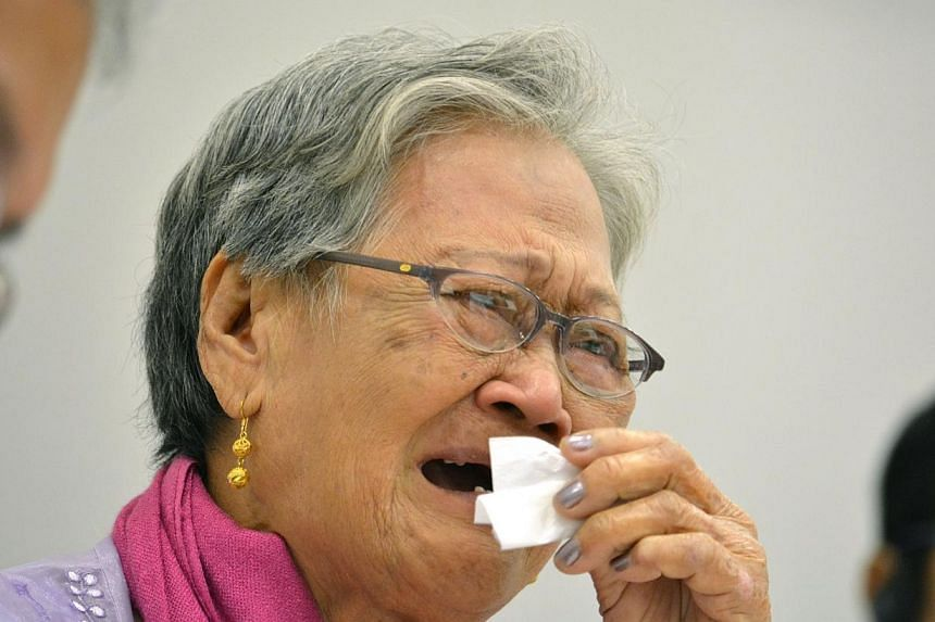 Eighty-four-year-old Estelita Basbano Dy of the Philippines reacts as she speaks during a meeting as part of the 12th Asian Solidarity Conference for the Issue of Military Sexual Slavery by Japan, at Japan's House of Representatives office building i