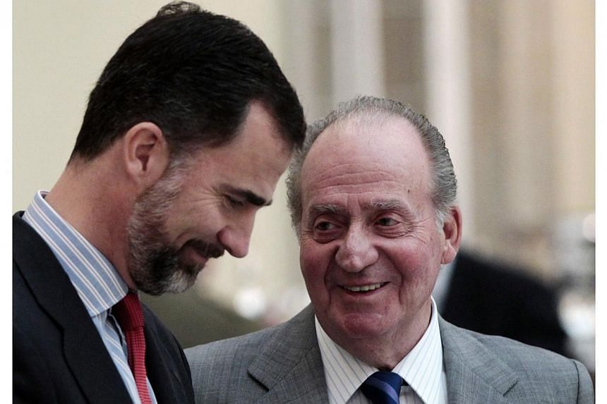 Spanish King Juan Carlos (right) talks to his son Crown Prince Felipe during the Spanish National Sport Awards ceremony at El Pardo Palace outside Madrid on Feb 28, 2011. The process of succession is underway in Spain after King Juan Carlos, 76, anno