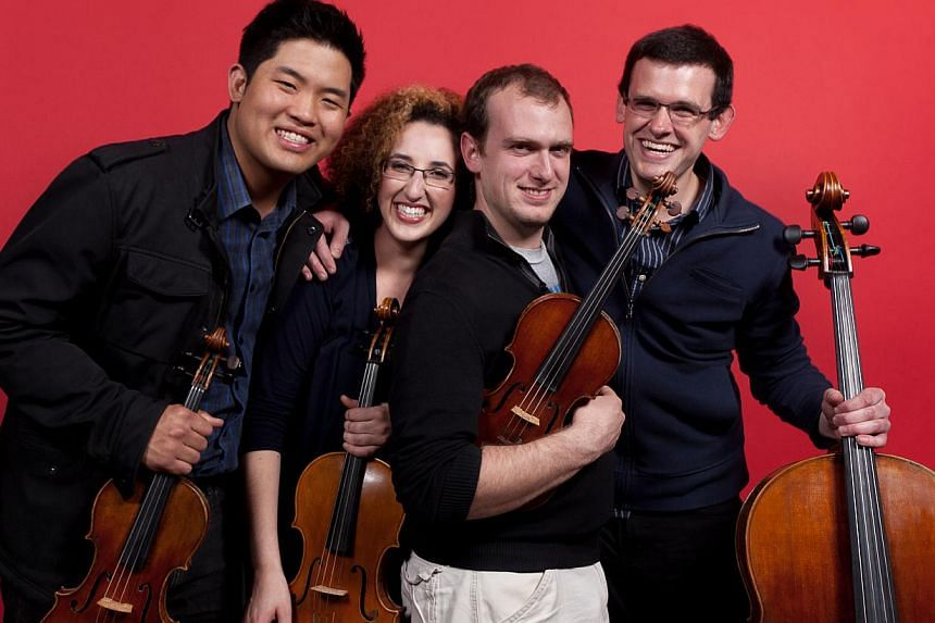 Singaporean violinist Jonathan Ong (left) is part of the Wasmuth Quartet which has swept major awards since its formation last January. -- PHOTO: COURTESY OF JONATHAN ONG