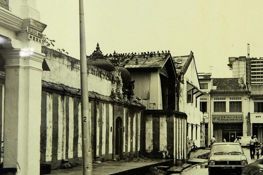 (Top) Sri Veeramakaliamman's unique silver flag post and (above) the old temple before a new one was built in the 1980s.