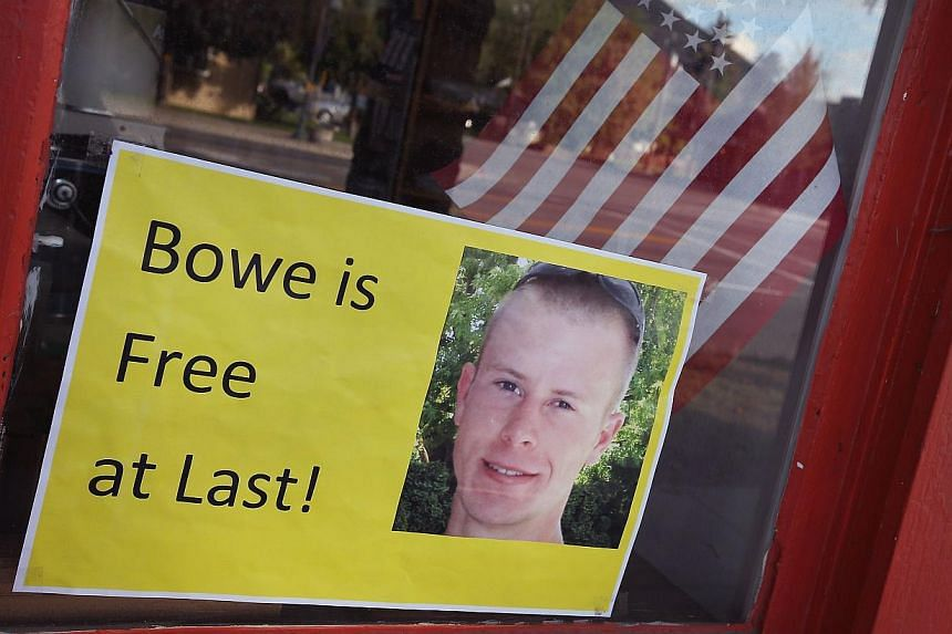 A sign announcing the release of Sgt. Bowe Bergdahl sits in the window of the Hailey Paint and Supply store on Main Street in Hailey, Idaho on June 1, 2014. -- PHOTO: AFP