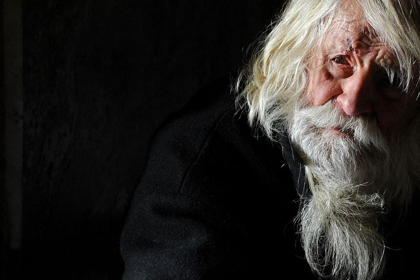 """The 100-year-old Dobri Dobrev, known as """"Grandpa"""" Dobri, begs for alms in the porch of the golden-doomed Alexander Nevski cathedral, in the center of Sofia, on April 20, 2014. -- PHOTO: AFP"""