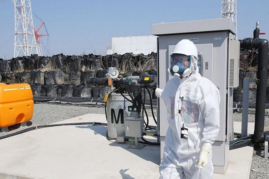 Japan will on Monday start constructing an underground ice wall at the crippled Fukushima nuclear plant, freezing the soil under broken reactors to slow the build-up of radioactive water, officials said. -- PHOTO: AFP