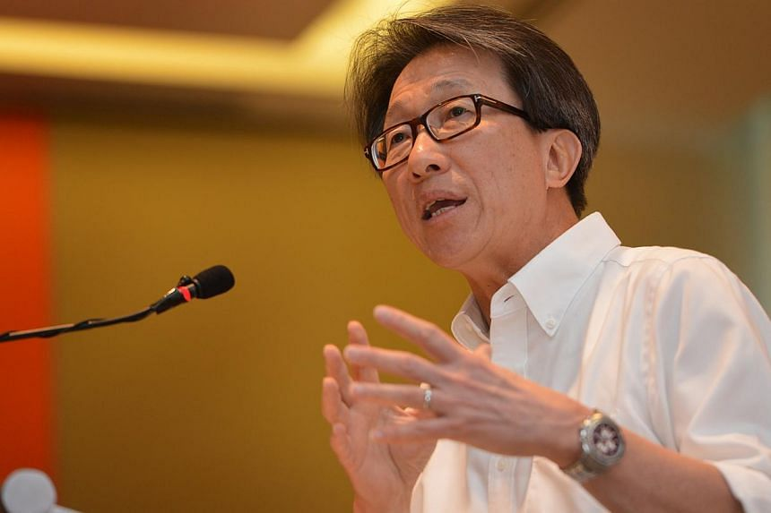 Mr Lim, who is NTUC's secretary-general, disclosed that employers had in fact wanted to drop the minimum amount altogether, saying that wages were already going up in the tight labour market. -- PHOTO: ST FILE