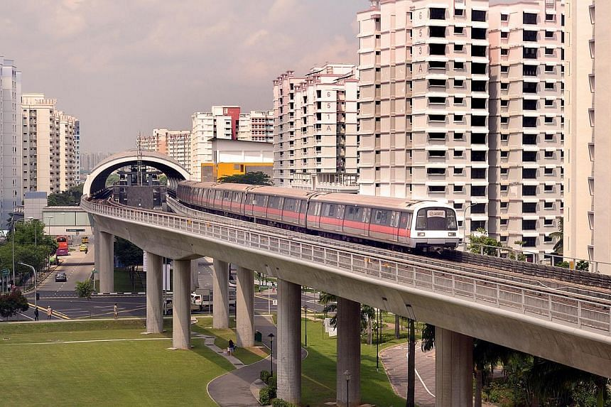 SMRT would provide video feeds from certain MRT stations, while Starhub would share anonymised telecommunications data. -- ST PHOTO: LIM SIN THAI