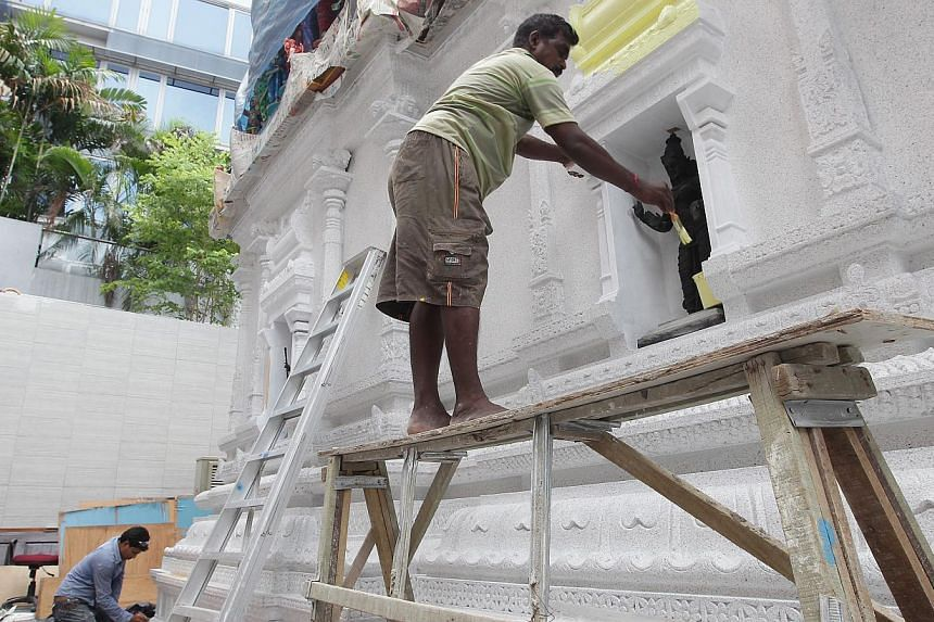 Workers seen at the Sri Veeramakaliamman temple along Serangoon Road while it was undergoing renovation and restoration works. -- ST PHOTO: NEO XIAOBIN