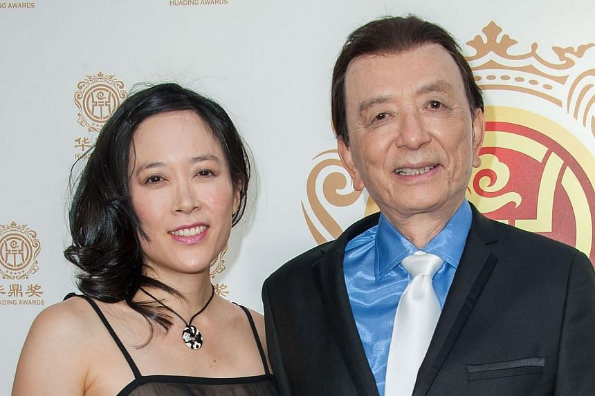 Actor James Hong (right) and daughter April Hong arrive at China's first Film Awards, Huading Film Awards, in Hollywood, California on June 1, 2014. -- PHOTO: AFP