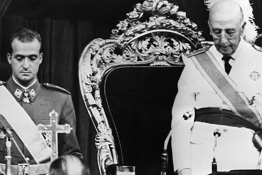 A photo taken on July 22, 1969, shows then Spanish Head of State, General Francisco Franco (right) beside his successor, Prince Juan Carlos, during a Cortes Session in Madrid. -- PHOTO: AFP