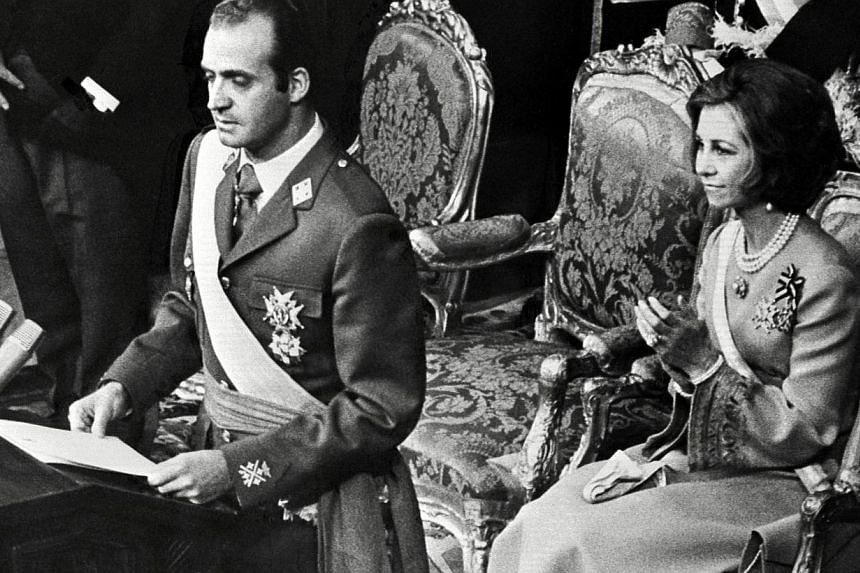 A file photo taken on Nov 22, 1975, shows Juan Carlos of Bourbon taking the oath in front of the Spanish Parliament, the Cortes, and the Kingdom's Council in Madrid, next to his wife, Queen Sofia. King Juan Carlos, who abdicated on Monday aged 76, le