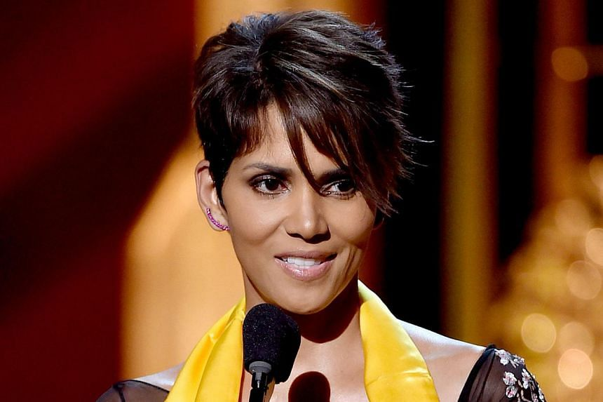 Actress Halle Berry accepts the Global Movie Icon Award onstage at the 2014, Huading Film Awards at The Montalban Theatre on June 1, 2014, in Los Angeles, California. China's Huading Awards ceremony was held for the first time in the United States on