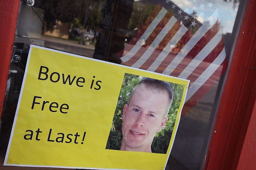 A sign announcing the release of Sgt. Bowe Bergdahl sits in the window of the Hailey Paint and Supply store on Main Street on June 1, 2014 in Hailey, Idaho. -- PHOTO: AFP