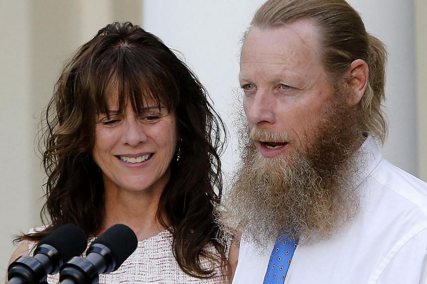 Bob Bergdahl (right) and Jami Bergdahl talk to reporters as they join U.S. President Barack Obama (unseen) for a statement about the release of their son, prisoner of war U.S. Army Sergeant Bowe Bergdahl, in the Rose Garden at the White House in Wash