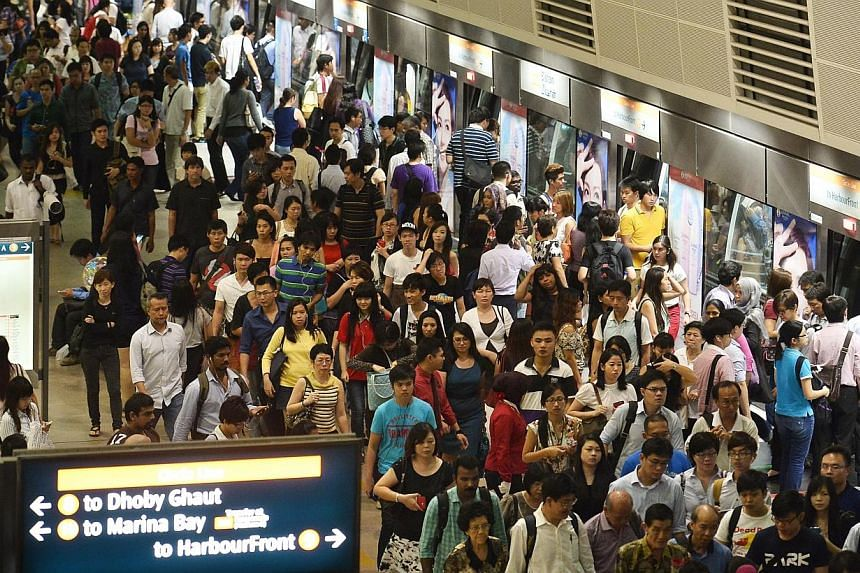 The peak-hour crowd at Bishan MRT station on 7 Oct 2013. Singapore has one of the most cost-efficient public transport networks in the world, according to a study released on Monday. -- PHOTO: ST FILE