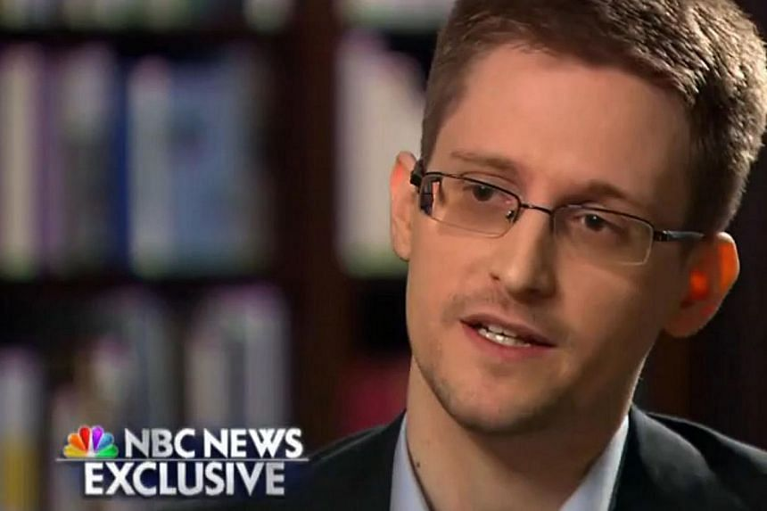 Former intelligence contractor Edward Snowden, wanted by US authorities and currently living in Russia, said in a TV interview on Sunday that he has applied for asylum in Brazil. -- PHOTO: AFP
