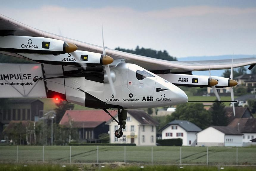 The solar-powered Solar Impulse 2 experimental aircraft takes off during its maiden flight at its base in Payerne on June 2, 2014.A sun-powered plane made a successful test flight in Switzerland on Monday, clearing a vital hurdle towards its go