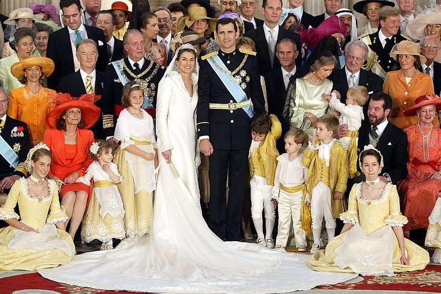 A file photo taken on May 22, 2004 shows Spanish Crown Prince Felipe of Spain (C-R) his wife Princess of Asturias Letizia Ortiz and King Juan Carlos of Spain (third row, 4th L) and Queen Sofia (third row, 4th right), posing for a family photo at the