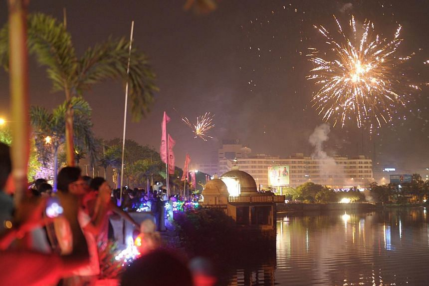 Indian supporters of Telangana watch as fireworks explode to celebrate India's 29th state, Telangana, in Hyderabad early on June 2, 2014. -- PHOTO: AFP