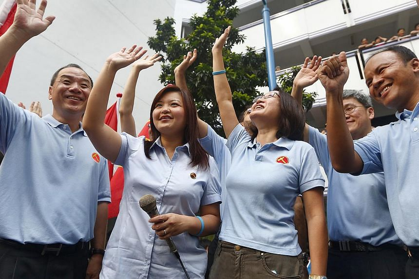 Workers' Party MPs during the party's thank you parade in Punggol East in January 2013. -- PHOTO: ST FILE