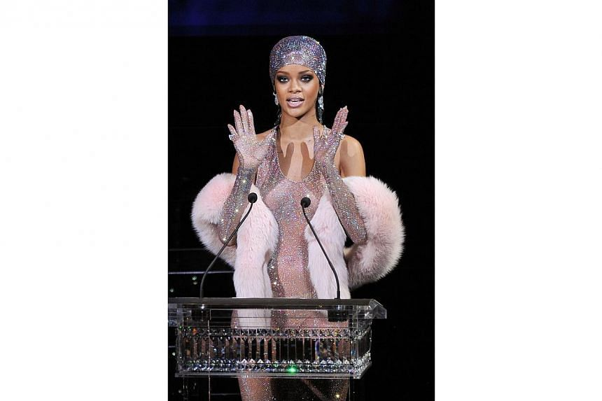 Rihanna speaks onstage at the 2014 Council of Fashion Designers of America Awards (CFDA)at Alice Tully Hall, Lincoln Center on June 2, 2014 in New York City. -- PHOTO: AFP