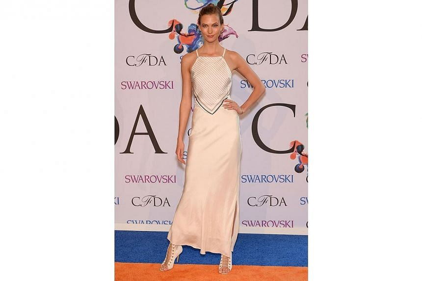 Model Karlie Kloss attends the 2014 CFDA fashion awards at Alice Tully Hall, Lincoln Center on June 2, 2014 in New York City. -- PHOTO: AFP