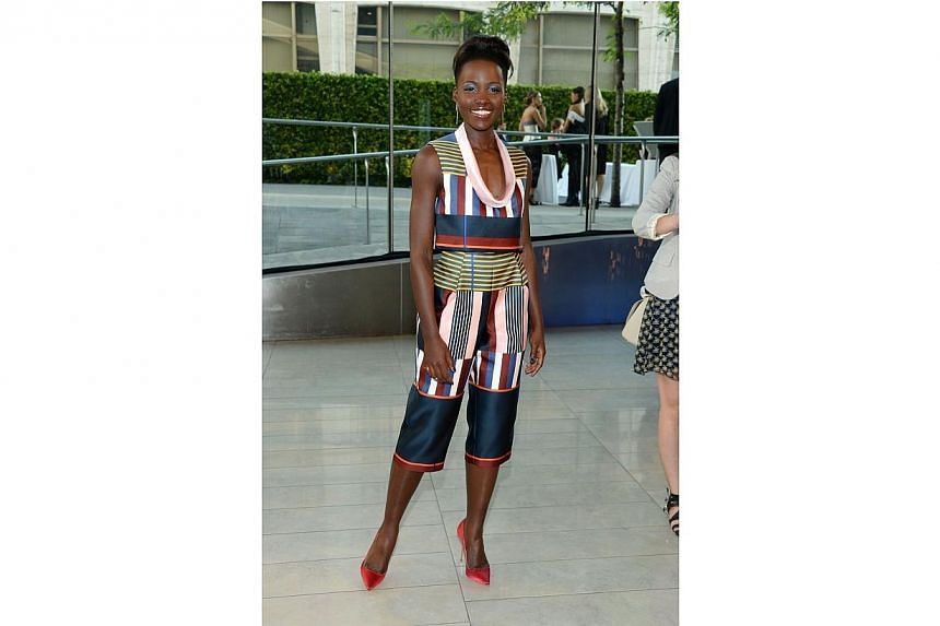 Actress Lupita Nyong'o attends the 2014 CFDA fashion awards at Alice Tully Hall, Lincoln Center on June 2, 2014 in New York City. -- PHOTO: AFP