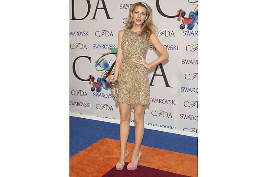 Actress Blake Lively arrives for the 2014 CFDA fashion awards at Lincoln Center in New York on June 2, 2014. -- PHOTO: AFP