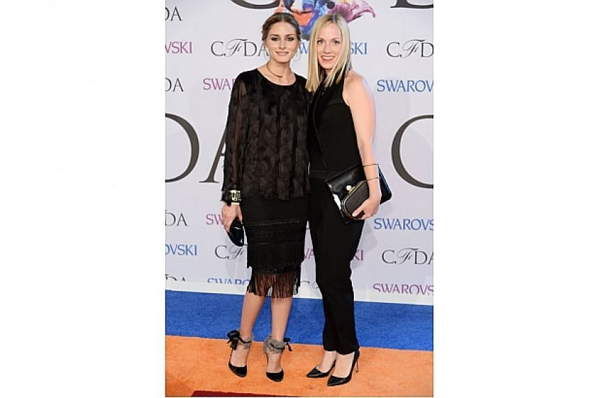 Olivia Palermo and Lisa Axelson attend the 2014 CFDA fashion awards at Alice Tully Hall, Lincoln Center on June 2, 2014 in New York City. -- PHOTO: AFP