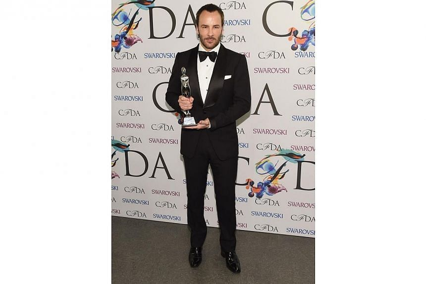 Geoffrey Beene lifetime achievement award recipient Tom Ford attends the winners walk during the 2014 CFDA fashion awards at Alice Tully Hall, Lincoln Center on June 2, 2014 in New York City. -- PHOTO: AFP
